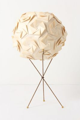 Paper Leaves On Globe By Pierre Malbec