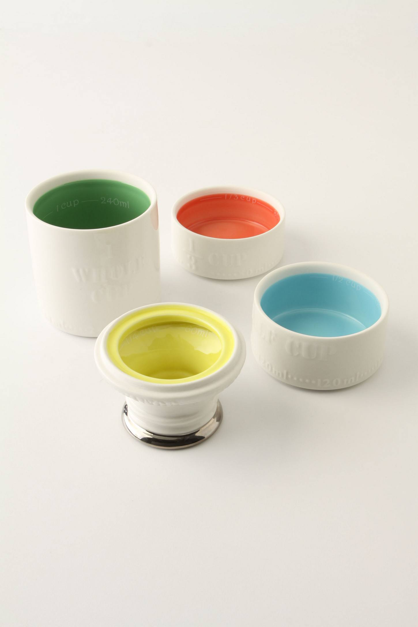 Milk carton measuring cups with colors inside