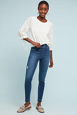 Slide View: 1: Spanx Mid-Rise Distressed Denim Leggings