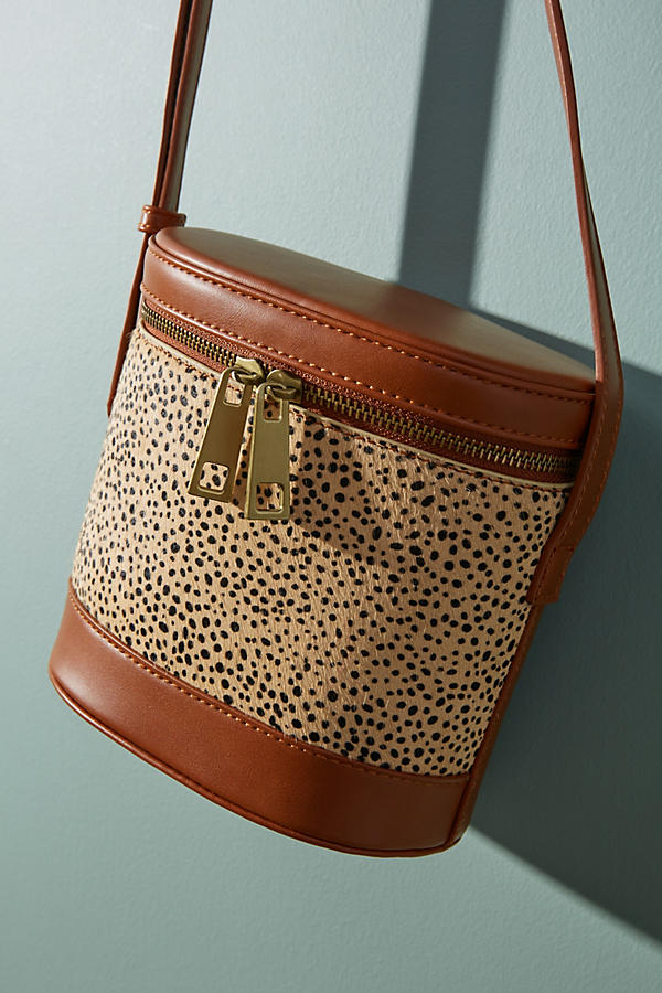 Slide View: 1: Cylindrical Animal Print Crossbody Bag