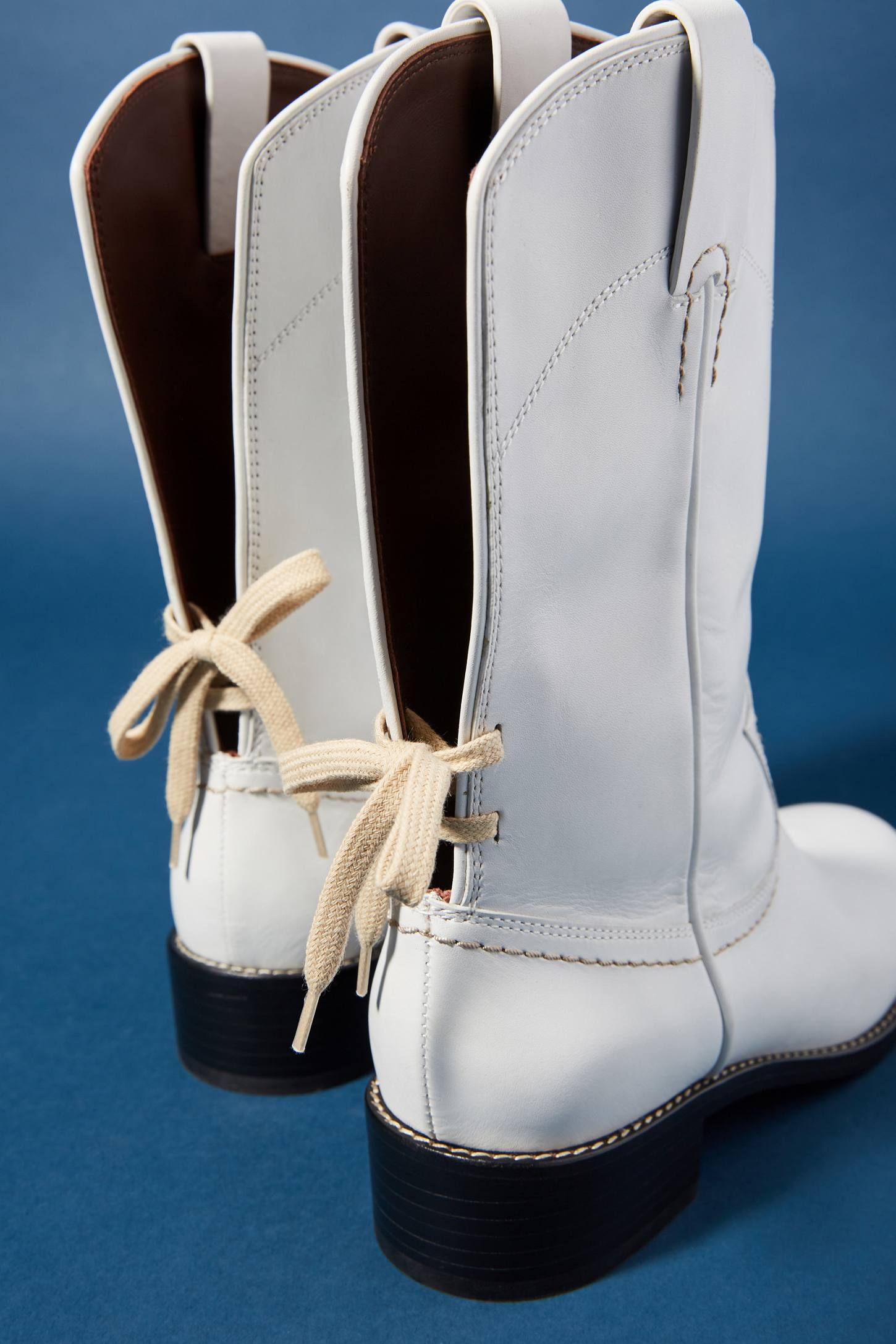 Open back Western boots with lace up detailing